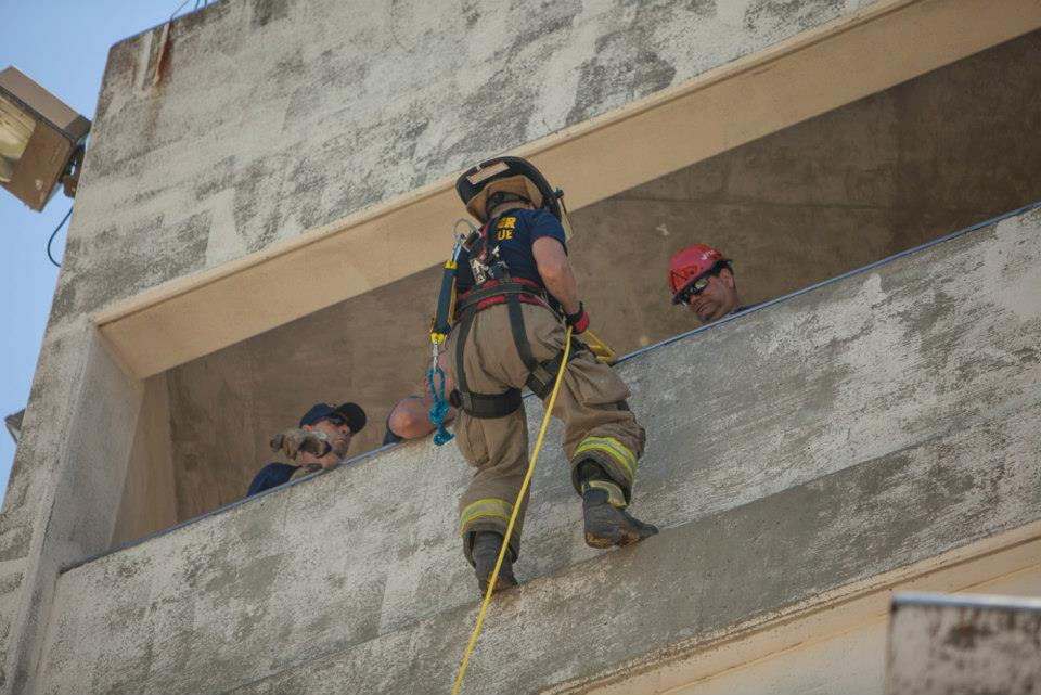 Firefighter practicing rapelling